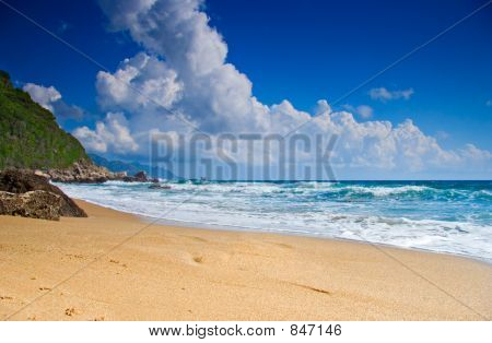 Empty beach with clouds