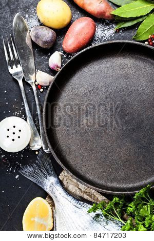 Food background with Fish and Vegetables. Lots of copy space