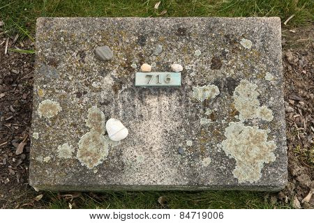 Jewish stones put on the grave an unknown victim of the Ghetto Terezin at the National Cemetery in Terezin, Czech Republic.