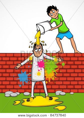 Cute little boy standing on a wall and pouring color to a man on occasion of Indian festival, Holi celebration.