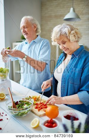 Senior husband and wife cooking together
