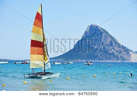 Scenic Italy Sardinia beach resort landscape with sail boat and mountains