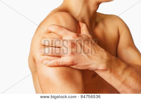 Pain in a male shoulder