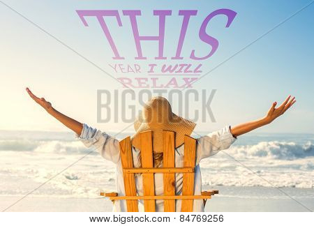Woman relaxing in deck chair by the sea against this year i will relax