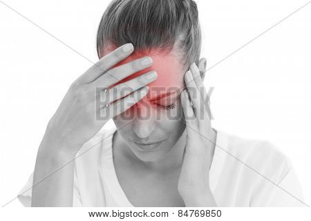 Woman having a headache with her head in her hands on white background