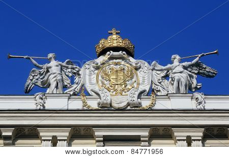 VIENNA, AUSTRIA - OCTOBER 10, 2014: Architectural artistic decorations on Hofburg palace, Vienna; Austria. Hofburg was residence of Habsburg dynasty, rulers of Austro-Hungarian Empire. Vienna, Austria