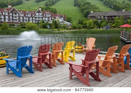 COLLINGWOOD, ON, CANADA - JUNE 18: Colorful deck chairs on Mill pond dock in summer at Blue Mountain Village, 2014
