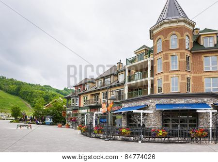 COLLINGWOOD, ON, CANADA - JUNE 18: Copper Blues restaurant patio and shops near summer ski hill at Blue Mountain Village, 2014