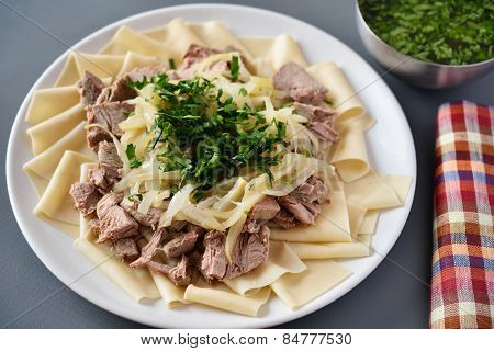 Traditional dish of Turkic people in Central Asia Beshbarmak. Focus on the greens