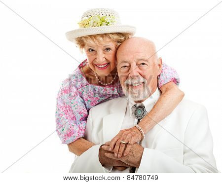 Portrait of beautiful senior couple dressed in Southern style.  Isolated on white.