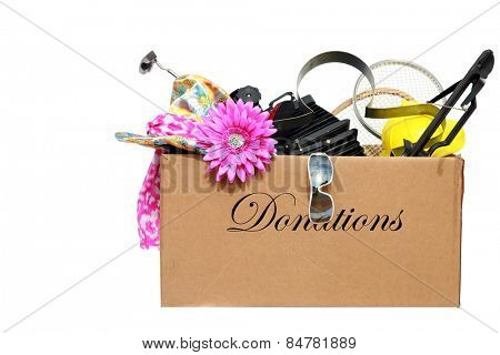 A large cardboard box filled with donations for a charity or good cause. isolated on white with room for your text. donations are used by the needy around the world.