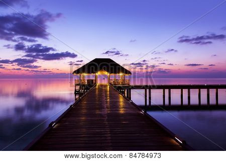 Water cafe at sunset - Maldives vacation background