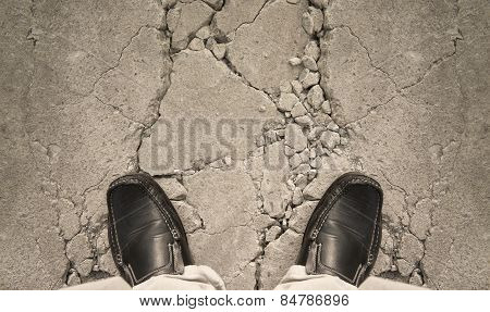 A Man Standing On Crack Ground