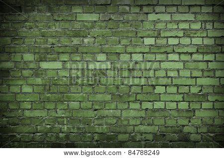 Close up of a Green Worn Brick wall