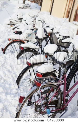 Parked Bicycles in the snow at winter