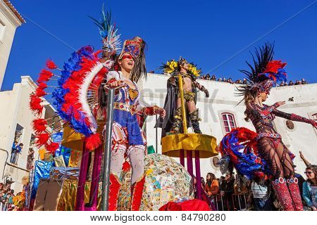 Sesimbra, Portugal. February 17, 2015: Samba dancers performing on top of a Float in the Rio de Janeiro Brazilian style Carnaval Parade.