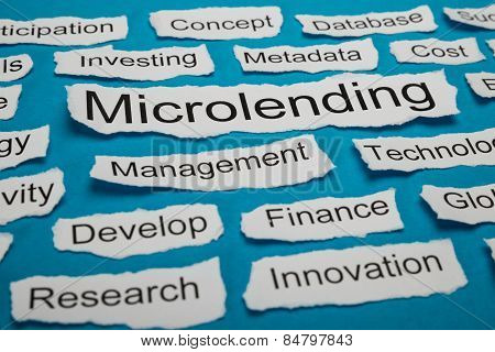 Word Microlending On Piece Of Torn Paper