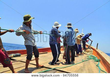 Nha Trang, Vietnam - May 5, 2012: Fishermen Are Catching Tuna With A Trawl Net.