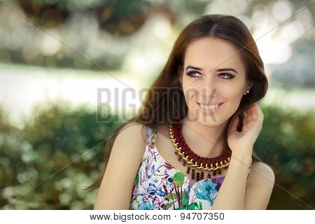 Smiling Woman Wearing Floral Dress and Big Necklace