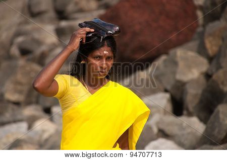 Pilgrim In Yellow Sari On The Papanasam Beach. Varkala