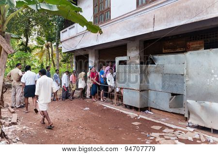 People Stand In A Queue To Alcoholic Shop. Varkala