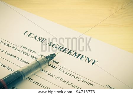 Lease Agreement Contract Document And Pen Bottom Left Corner Vintage Style