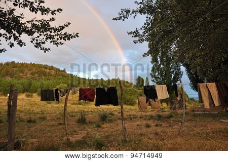 Hanging clothes and rainbow
