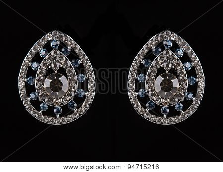 earrings with jewels on the black