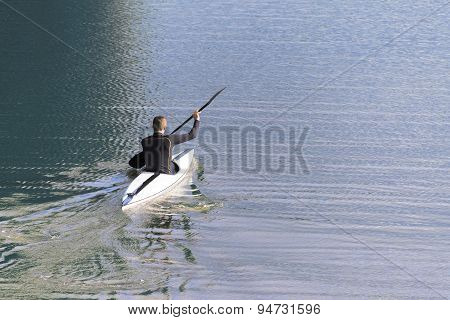 Paddler In A Kayak Alone On The Blue Water, Copy Space