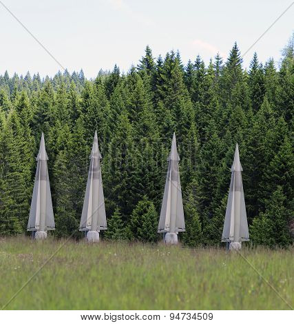four big military missiles hidden in forests ready to be launched poster