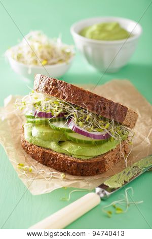 healthy rye sandwich with avocado cucumber alfalfa sprouts poster