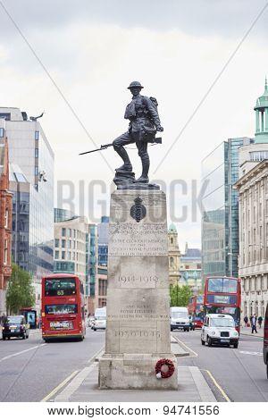 LONDON, UK - JUNE 23: Royal Fusiliers war memorial, by Albert Toft, in between traffic lanes in Chancery Lane. June 23, 2015 in London.