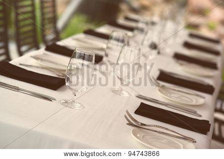Table Setting. Glasses And Plates On Table In A Restaurant