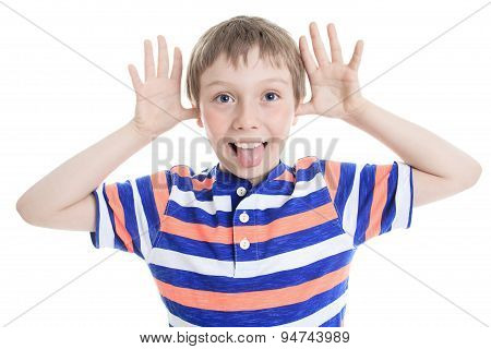 Little boy wincing on white background
