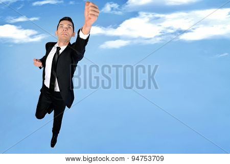 Super hero concept of business man fly