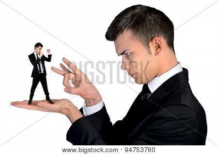 Isolated business man finger flipping on little man