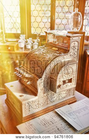 Vintage cash register in an old pharmacy poster