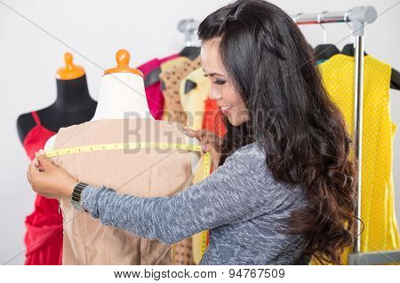 Fashion Designer Or Tailor Working On A Design Or Draft, Isolated