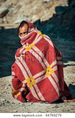 SARCHU, INDIA - SEPTEMBER 2, 2011: Indian man muffled in blanket on cold morning on Manali-Leh road in Himalayas in Ladakh, India