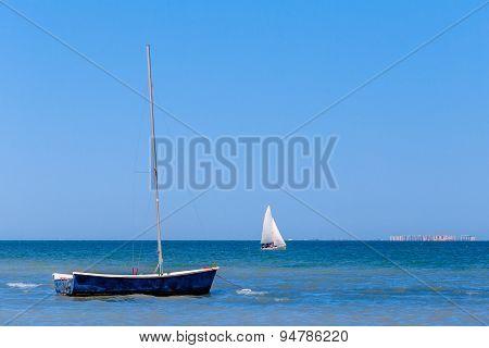 Calm blue sea with sailboats