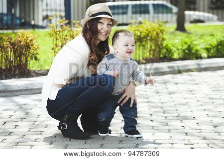Young mother with her baby boy