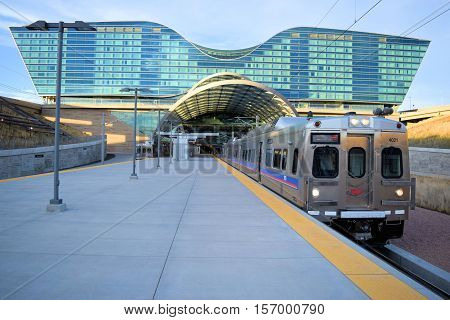 November 16, 2016 in Denver, CO:  Light Rail Train departing the Denver Airport Station to Union Station which is a transportation hub in Downtown Denver and where people can commute from the airport to Downtown Denver and beyond