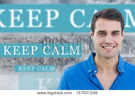 The word keep calm and handsome man smiling to the camera against room with large window looking on city