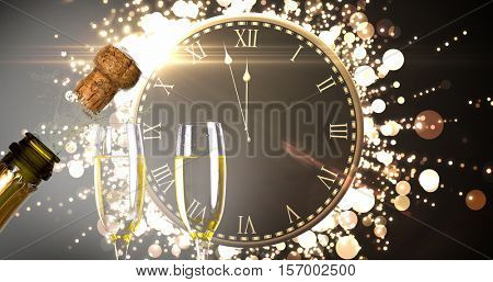 Clock counting down to midnight against close up of champagne cork popping