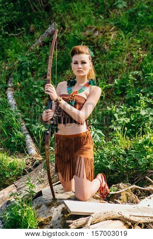 Young Beautiful Amazon Girl Hunting In The Forest
