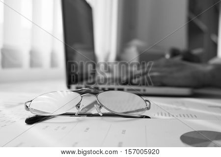 focus at glasses and background of meeting roommonochrome black and white tone.