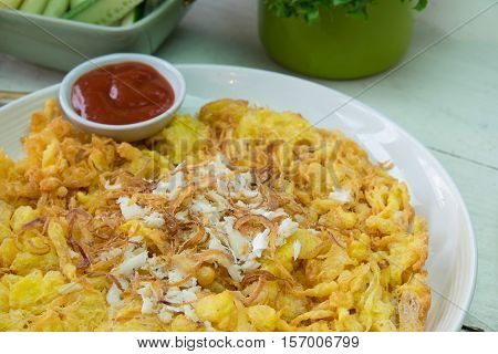 Omelet with crab fusion food in thai.