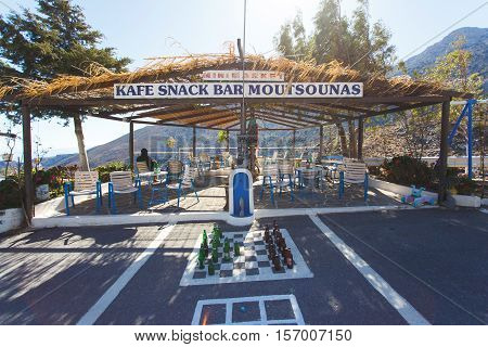 Zenia Greece - October 15 2016: Chess board on the pavement in the Olive Tree roadside cafe on the serpentine road to the Lassithi Plateau