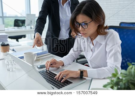 Business lady feels pressure working under control of her boss