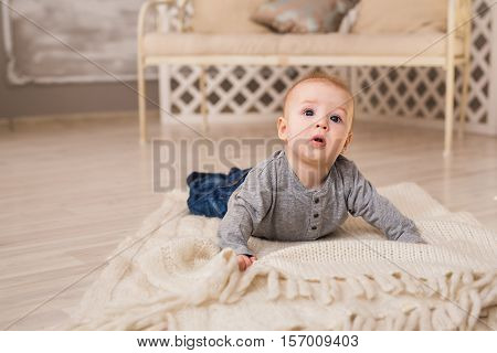 Portrait of little cute baby boy lying